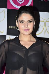 Zarine Khan in a Pink Mini Skirt and Transparent Black Top Looks Beautiful