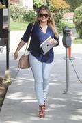 http://img294.imagevenue.com/loc562/th_129651504_Hilary_Duff_at_hair_salon_in_Beverly_Hills6_122_562lo.jpg